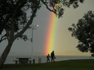 Rainbow_At_Maraetai_Beach_New_Zealand