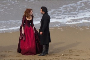 The Poldark crew return to film more scenes on a sunny but cold day at Holwell Bay, 3 March 2016. Aiden Turner playing Captain Ross Poldark was there in his trademark outfit. Poor Eleanor Tomlinson, playing Demelza repeatedly having to get her feet wet. Cold water on her long dress adding to the weight. A hot water bottle and extra clothes ready the second they stopped filming.